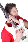 Man enthusiastically playing his guitar