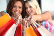Women holding out their shopping bags