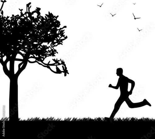 Man running in park in spring silhouette
