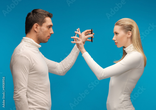 man and woman with modern gadgets
