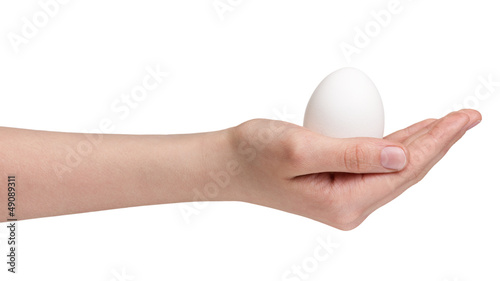 female teen hand holding egg