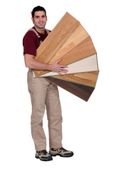 Carpenter with an assortment of flooring