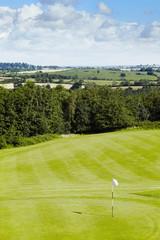 Golf course hole on a sunny day