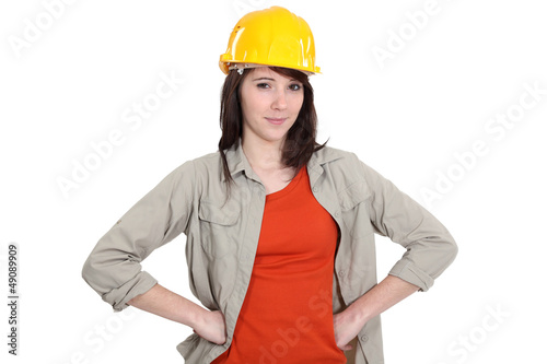 Confident young female builder