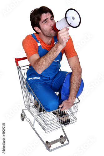 Man with a loudhailer in a trolley