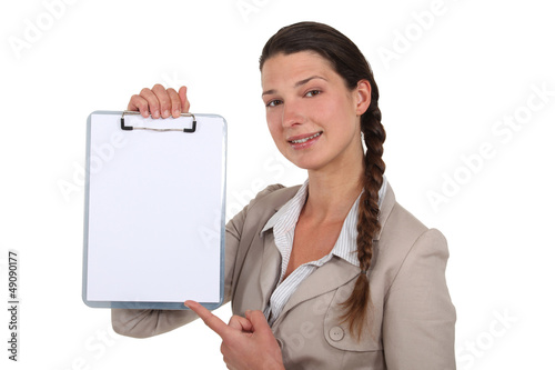 Businesswoman with a blank clipboard