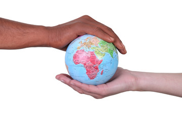 Hands cupped around a globe