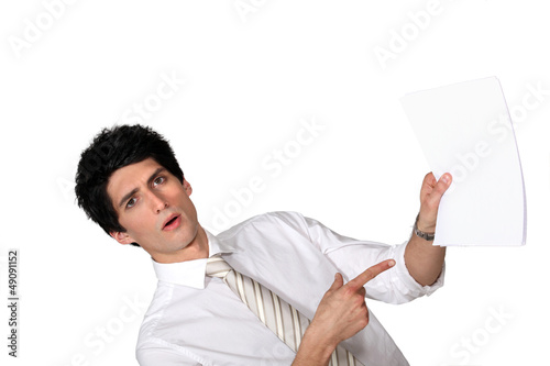 Surprised man showing a document