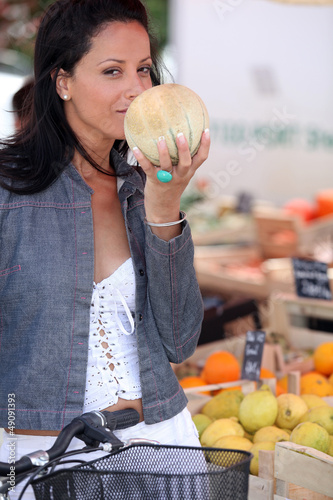 Woman buying fruit at market
