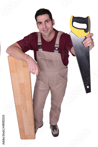 Craftsman with saw and wooden slat