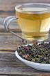 Green leaves tea on a plate