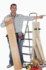 Carpenter pointing at empty copy space