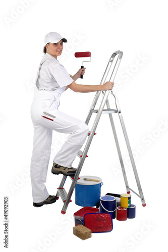 Painter climbing stairs