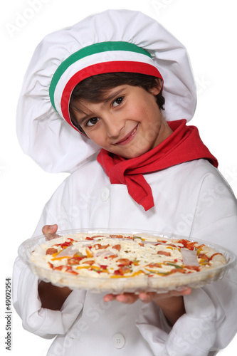 Horizontal photo of child with pizza