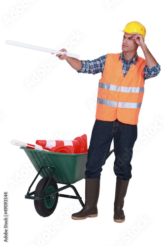 Road worker with a barrow full of cones
