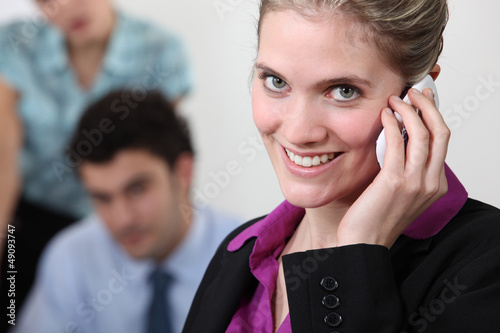Female office worker on the telephone