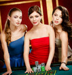 Three women stake playing roulette at the gambling house