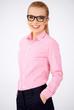 Portrait of a happy blonde geek girl wearing glasses