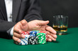 "Poker player going ""all in"" pushing his poker chips forward"