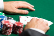 Poker player opens his cards. Challenge to the casino