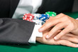 Poker player cheats with card from the sleeve