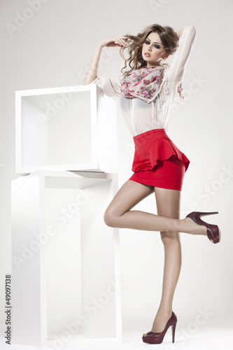 beautiful woman with long sexy legs dressed elegant - studio