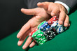 "Poker player stakes ""all in"" pushing his chips forward"