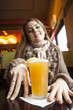 Young Woman with Beautiful Blue Eyes Drinking Hefeweizen Beer