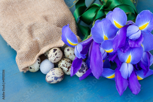 quail eggs in sack and irises