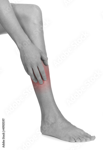 Women scratch itchy leg with hand.