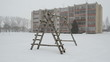 old wooden child playground winter blizzard snowstorm snow fall