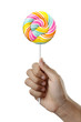 Hand holding Colorful Spiral lollipop candy, isolated