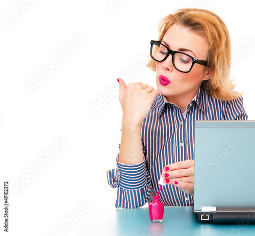 Business woman having a manicure and painting her nails on work