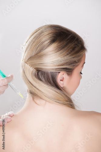 Frau bei der Impfung, Vorsorgeuntersuchung