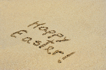 Conceptual handwritten text Happy Easter in sand