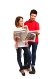Portrait of young couple reading newspaper isolated on white bac