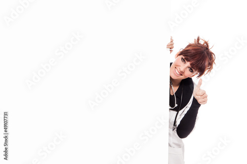 Smiling brunette female doctor with message board