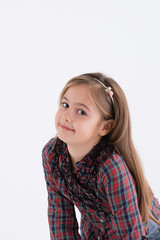 Cute little girl posing in studio