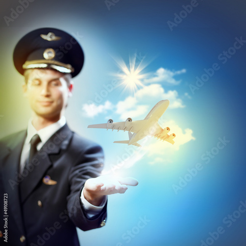 Image of pilot with plane in hand
