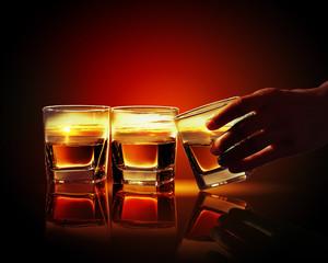 Three glasses of whiskey