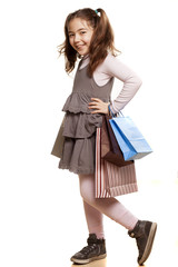 happy, pretty girl in a dress with shopping bags