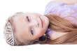 Beautiful little girl lay with tiara on head