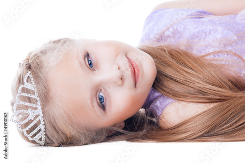 Beautiful little girl lay with tiara on head