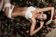 beautiful fashionable woman in lingerie with roses