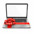 Laptop gift. Bow and ribbon on keyboard