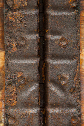 Metal hinge, natural rust, abstract textured backgrou