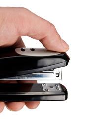 Hand holding black stapler, isolated on white