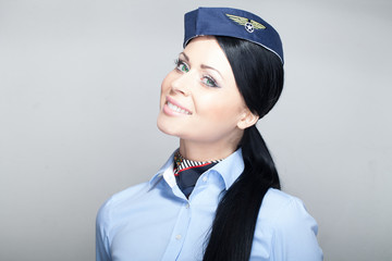 Young attractive stewardess smiling portrait