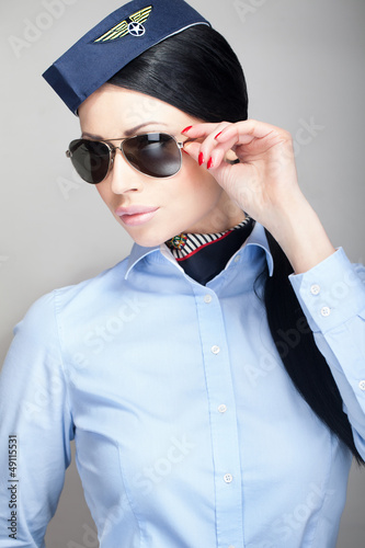 Young attractive stewardess with aviator sunglasses