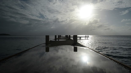 Pier stretching into the horizon of the Caribbean Time Lapse